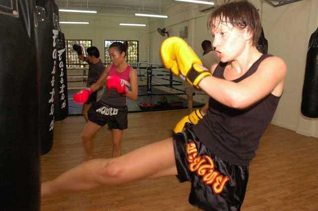 Girl Training in Muay Thai Kickboxing
